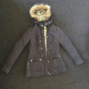 Free People parka with faux fur trimmed hood.